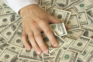 bigstockphoto_greedy_hand_grabs_money_2405774_5fh3